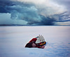Lost at Sea (AmyJanelle) Tags: blue red sky lake inspiration snow storm girl clouds photography boat poetry poems stormysky toyboat laying layingdown aesthetic modelboat lostatsea