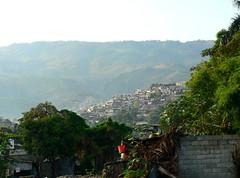 Haiti slum (chiptape) Tags: world poverty street city travel trees people urban house mountain green wall architecture lan
