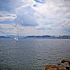 Everything's so blue.. (Rebeca Mello) Tags: ocean sea brazil sky costa sun water água clouds photoshop landscape boats coast mar rocks cityscape barcos sãopaulo sony sunny céu santos nuvens litoral sunnyday rochas cs5 sonyalpha200 rebecamello rebecamcmello asquaresuperstarstemple somecloudsincottoncandy