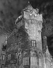 Casa Loma Tower (scilit) Tags: windows sky blackandwhite building brick tower castle monochrome stone architecture clouds movie gothic structure mansion turrets sincity hypothetical casaloma hogwart awardtree daarklands sailsevenseas