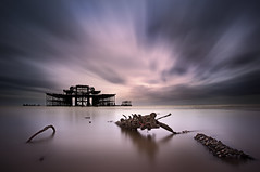 West Pier Remains (Tim_Clarke) Tags: longexposure sea cloud seascape colour beach water canon sussex pier movement sand ruins brighton purple cloudy calm westpier zen lowtide brightonbeach 1740 leefilters 5dii bigstopper