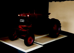 Tractors Can Be Very Dangerous (Steve Taylor (Photography)) Tags: red newzealand brown tractor black art metal contrast digital dark cub scary glow farm eerie spooky machinery nz vehicle southisland stark farmall frightening mccormick greymouth