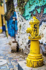 Yellow extinguisher (danigutib) Tags: chile street camera blue urban muro verde green water yellow azul wall hydrant fire photography valparaiso photo calle reflex agua nikon df iron colours grafiti steel hill colores amarillo cerro urbano fotografia tap nikkor dslr passage cemento extinguisher 58mm camara grifo steady acero concret hierro concreto pasaje recto adoqun nikondf