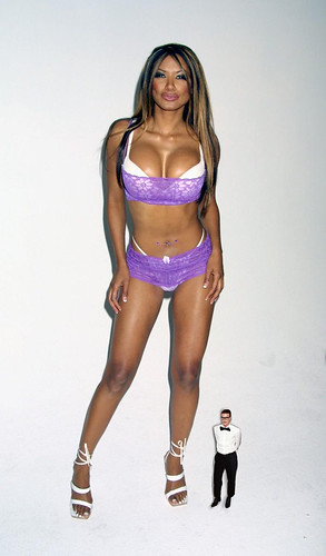 Traci Bingham With A Small Man