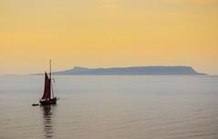 Red Sailed Boat and Isle of Eigg, near Mallaig, Scotland (periurban) Tags: sailboat sail eigg isleofeigg redsail