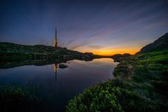 Ulriken, Bergen, Norway (Paulius Bruzdeilynas) Tags: sunset summer sky sun mountain reflection water weather norway night evening norge pond sony calm norwegian bergen ulriken sonyalpha sonya7ii