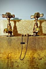 taps (Jez Blake) Tags: gold sink chain taps plug grime