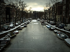 Reguliersgracht Winter (N+C Photo) Tags: travel trees winter vacation orange holiday holland building tourism netherlands dutch amsterdam les architecture clouds boats photography design casey nikon nadia europe iamsterdam earth expression culture photographers eu structure adventure explore viajes artists coolpix ajax traveling fotografia bas turismo mokum pays vacaciones mundo travelers amstel niederlande discover aventura tierra benelux reguliersgracht hokum travel1 descubrimiento pasesbajos snowice traveladventure p7100 mygearandme leshollandes