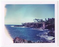 Overlooking the bay (ryan-c.com) Tags: ocean blue sea cliff house mist tree water polaroid hawaii bay rocks pacific diving maui spray hut cast land 340 669 honalua
