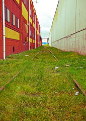 Interbuilding railway () Tags: old city urban usa colors architecture america buildings grit washington industrial state pacific northwest bright district united gritty historic valley vegetation tacoma states nalley