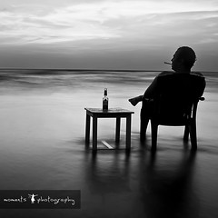 this is where i go in my dreams.. (PNike (Prashanth Naik)) Tags: longexposure beach water sky man smoking relaxing nikon d7000 pnike india asia goa ashwem clouds sun sand table chair