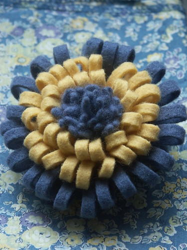 Fringed felt flower