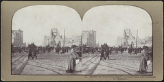 Market St. from ferry depot -- Chronicle and Call buildings in distance (Boston Public Library) Tags: pedestrians bostonpubliclibrary bpl stereographs photographicprints sanfranciscoearthquakeandfire1906 streetrailroadtracks