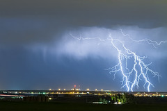 Northeast Colorado Lightning Strike and City Lights (Striking Photography by Bo Insogna) Tags: city blue light sky cloud storm nature rain weather electric skyline night dark lights colorado energy cityscape power view flash dramatic bolt electricity strike thunderstorm lightning lightening electrical thunder climate extremeweather thunderbolt severethunderstorms jamesinsogna