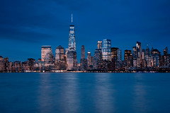 Skyline of New York City (roken-roliko) Tags: blue reflection building tower water skyline modern buildings lights cityscape exterior towers nopeople panoramic manmade nycskyline nycnewyorkcity buildingexterior withoutpeople architectureexterior skylineofnewyorkcity rolandshainidze