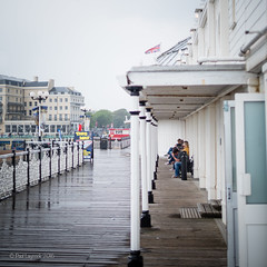 Sitting it Out (amipal) Tags: uk greatbritain england wet rain sussex pier brighton unitedkingdom gb palacepier
