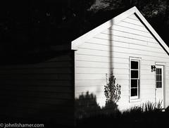 Garage Shadows (johnlishamer.com) Tags: sky bw 120 film home clouds 35mm mediumformat hc110 wideangle 20mm 6x7 springtime expiredfilm nikonfa fujineopan400 2016 nikkor50mm bataviail red25filter mamiyarb67prosd fujineopan400expired lishamer photoexif johnlishamercom