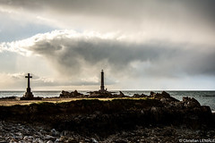 Cap de la Hague - Goury (christian_lemale) Tags: sunset sea sky mer lighthouse france clouds coast soleil nikon coucher cte hague ciel cap cape nuages phare coucherdesoleil calvary calvaire cotentin capdelahague goury d7100