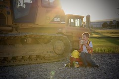 Long Hours (SaltyDogPhoto) Tags: boy sunset childhood cat children lunch creativity photography evening construction nikon break child photoshoot flash creative equipment caterpillar lensflare dozer nikkor bulldozer strobe intothesun photooftheday handson intothelight flickrfriday childrenphotography strobist nikonphotography nikkorafs50mm118g nikond7200 saltydogphoto