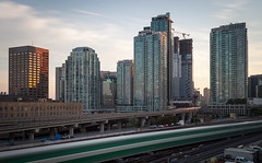 GO On The Move (Jack Landau) Tags: city urban toronto ontario canada building skyline architecture skyscraper train buildings evening highway long exposure downtown outdoor dusk south tracks rail highrise infrastructure gardiner expressway complex core southcore
