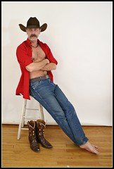 Relaxing Cowboy (Cowboy Tommy) Tags: red portrait hairy man hot male feet face hair fur model furry cowboy nipples boots muscle chest handsome wranglers stomach moustache jeans western stache tight cowboyhat stud bulge cowboyboots pec