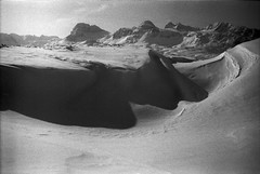 Dunes in a Desert of Snow (pablopao) Tags: winter shadow bw mountain snow film ice desert dunes leicam6 xtol summicron50mmf2 kodaktrixdevelopedinxtoliso1600 overexposediso800