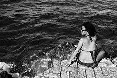 on a rock by the sea (gorbot.) Tags: sea summer blackandwhite bw f14 sicily roberta canoneos5d nikonfmount planar5014zf silverefex carlzeisszf50mmplanarf14 eosadaptor kafarahotel