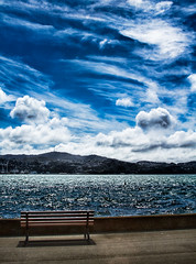 Have a seat and enjoy the view, Wellington, New Zealand (Explored) (stewartbaird) Tags: sea newzealand sky cloud clouds canon bench harbour bue 7d wellington sxbaird stewartbaird
