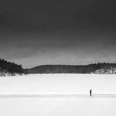 Frozen Lake.. (Peter Levi) Tags: bridge trees blackandwhite bw lake snow man blancoynegro ice water frozen forrest sweden stockholm blackwhitephotos