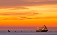 boat by the sea at sunset (lucmena) Tags: ocean california sunset sea sky seascape beach water boat colorful pacific dusk manhattan cargo transportation