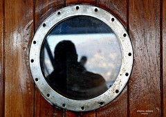 on the ship (dimitra_milaiou) Tags: world life door wood travel blue light shadow sea people man texture love window glass silhouette metal ferry port reflections island greek happy design boat wooden nikon rust holidays europe alone ship earth weekend salt hellas rusty happiness athens greece hora porthole planet lonely nautical shipping rounded vacations chora andros cyclades circular dimitra rafina ormos gavrio batsi d90 scuttle f3556 livadia supperferry 18105mm         milaiou