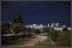 Just before the rain. (Colpics) Tags: italy puglia darkclouds alberobello digitalcameraclub stormapproaching canoneos5dmkii canonef2485mmusmlens