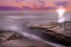 Newcastles Setting Sun (edwinemmerick) Tags: newcastle nsw australia sea coast ocean shoreline boats ships sunset clouds sky weather rocks longexposure slowshutter canon eos 20d edwin emmerick edwinemmerick