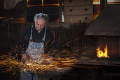 Reuven Anati, the Blacksmith (Flavio~) Tags: portrait hammer work flash environmental blacksmith strobe artificiallight strobes