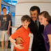 Neil deGrasse Tyson models with future scientists at the Hunt Library.