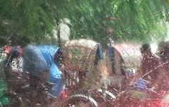 On a Rainy Day (Kaniz Khan 2009) Tags: road street trees green wet rain season movement traffic crowd transport vehicles transportation dhaka rickshaw jam trafficjam bangladesh pouring raindrop downpour soaked rainyseason kanizkhan