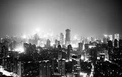 Shanghai black (marin.tomic) Tags: china city travel urban blackandwhite bw black monochrome night skyscraper asian lights hotel nikon asia view shanghai nightshot chinese citylights highrise metropolis d40
