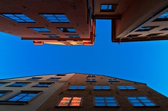 17th Century Skyscrapers... Stockholm Old Town (Maria_Globetrotter) Tags: old blue orange reflections town day sweden stockholm lookup clear gamlastan february oldtown estocolmo marias 2012
