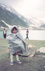 Ovais Adhia at Lake Saif-ul-Mulk (Year 1989) (Ameer Hamza) Tags: family pakistan people mountain lake snow cold classic beautiful asian wrapped pakistani shawl northern malka saifulmulk lakesaifulmulk lakesofpakistan fototrove ameerhamzacollection hanifadhiacollection