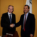 European Council President Herman Van Rompuy shakes hands with Abdelali Haoudi, vice president of research at the Qatar Foundation