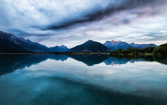 Dawn Breaks Over The Mountains, New Zealand (Explored) (stewartbaird) Tags: pink blue newzealand sky cloud lake snow mountains reflection nature water beautiful clouds sunrise canon landscape outside outdoors dawn living still scenery peace outdoor south peaceful calm hills lotr 7d otago nik lordoftherings gentle canon7d sbfaves sxbaird landscapelovers stewartbaird