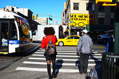 Intersection. (Rachel Citron) Tags: thelocaleastvillage theother nytimesblog newyorktimesblog lens photojournalism unionsquare afro militaryjackets streetstyle fashion alternativefashion fashionweek manhattan downtown africanamerican earmuffs leatherbackpack fishnets boots mta transitservice servicechanges mayorbloomberg nyctaxi intersection crosswalk urbanoutfitters vintage beaconscloset newyorkcity nyc