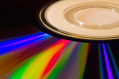 Spectrum of light on a compact disc (Circum_Navigation) Tags: backup light music color macro film closeup digital silver computer circle movie pc dvd video media shiny ray technology spectrum image background cd optical storage equipment entertainment disk blank software sound refraction record laser data medium disc information audio multimedia compact cdrom cdrw megabytes