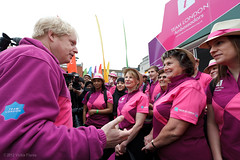 Mayor Boris Johnson meets Team London ambassadors to reveal their pink and purple Olympic Games uniforms - 16 March 2012 (VickieFlores) Tags: pink london public pod uniform purple volunteers wimbledon ambassadors sw19 2012 olympicgames unveil london2012 teamlondon mayoroflondon wimbledonstation trilbyhat borisjohnson informationpod teamlondonambassadors