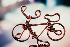 let's go ride. (theperplexingparadox) Tags: hk bike bicycle bronze toys hongkong souvenirs wire dof bokeh kitlens cycle fixie 1855 canon1855 goldcoast shallowdof canonefs1855mmf3556 400d wiretoys bronzewire
