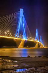 rio bridge (dtsortanidis) Tags: street longexposure bridge blue light sea sky west reflection rio yellow bulb architecture night port photoshop canon reflections dark 50mm bay interestingness interesting shadows purple nightshot harbour streetlamp mark pylon greece ii western 5d lamps fullframe hdr mk dimitris patras patra antirio peloponnese dimitrios photomatix peloponnisos antirrio charilaostrikoupis patraikos tsortanidis