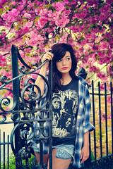 So, Dear (Belcantosoprano) Tags: flowers red portrait flower tree girl beautiful gate gorgeous magenta makeup lynchburg redlips nosering brunette kirstie pinkflowers portriats flowertree