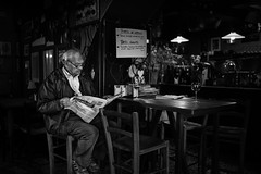 Newspaper, wine and light (Giulio Magnifico) Tags: life lighting morning light inspiration news man black glass composition contrast vintage relax lights newspaper intense thought artist alone shadows emotion wine candid citylife thoughtful streetphotography thoughts painter aged osteria genuine udine nikond800e