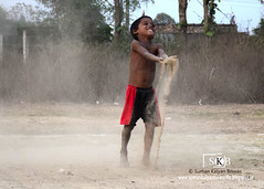 Dusty Happiness (Suman Kalyan Biswas) Tags: india game dusty smile face childhood playground fun kid funny child play outdoor expression happiness portraiture dust enjoyment westbengal childhoodgames  bethuadahari   playingwithdust portraitureinmotion       sumankalyanbiswasphotography
