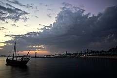 Evening Clouds (Sanjiban2011) Tags: park longexposure sky cloud nature water clouds skyscape evening boat nikon waterfront cloudy outdoor dusk corniche d750 fullframe fx tamron cloudscape doha qatar dhow miapark monsoonclouds tamron2470